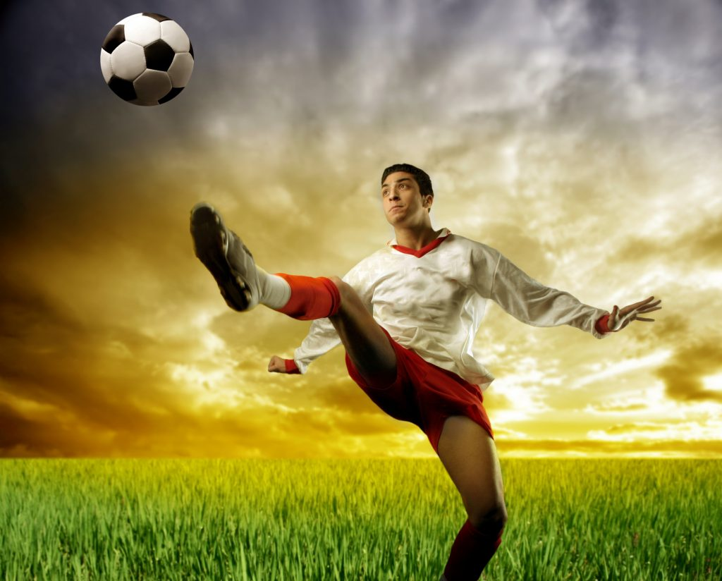 Male athlete in comfortable antimicrobial underwear kicking a ball