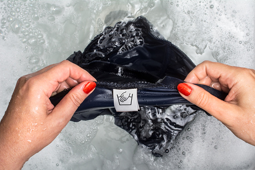 washing underwear in cold water by hand to remove poop stains